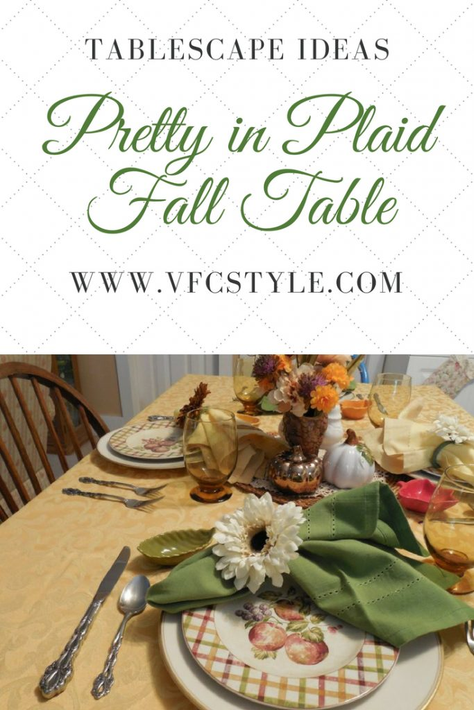 """Plaid plates and amber glassware make a """"Pretty in Plaid"""" tablescape for Fall at Vintage Floral Cottage! #thanksgivingtablesetting #thanksgivingtable #thanksgivingtablescape #tablescapeideas #tablescaping #tablescape #falltablescape #easyfallcenterpiece #fallcolorstablesetting #falltable #autumntable"""