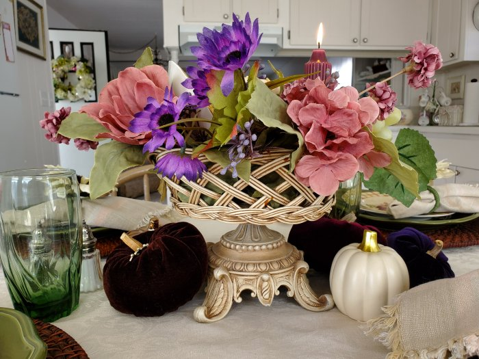 Thanksgiving Fall centerpiece with jewel tone pumpkins and pedestal basket container